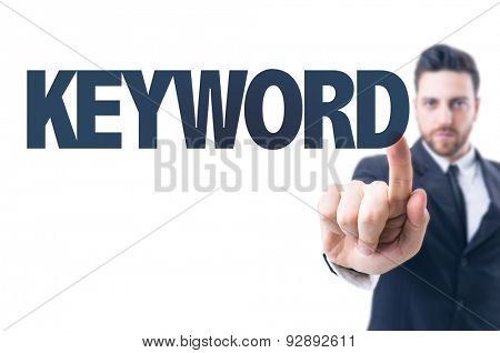 Business man pointing the text: Keyword