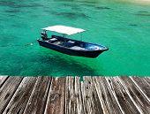 Beautiful beach with motor boat at Tioman island, Malaysia poster