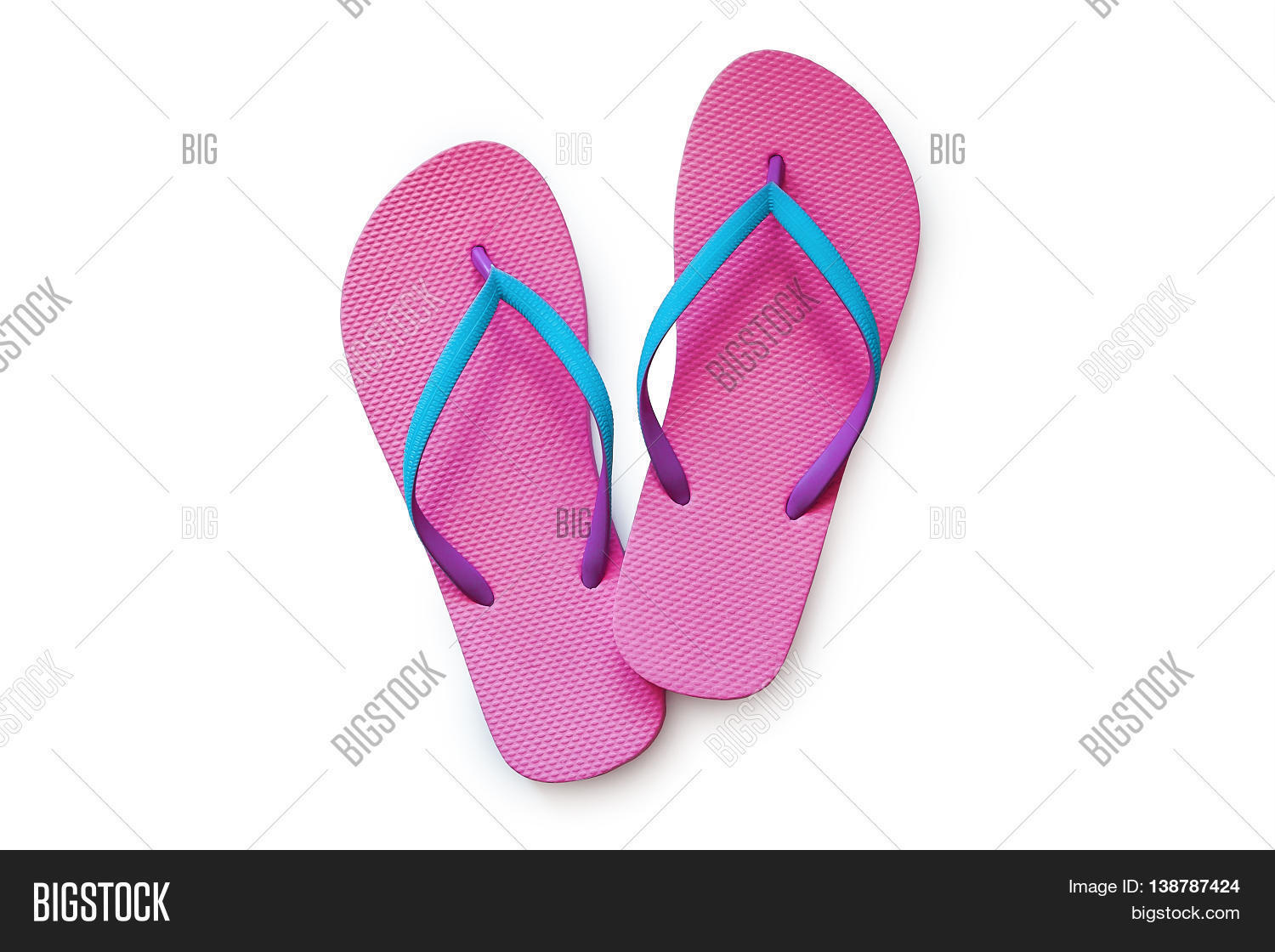 904e18dddcfc Pink flip flops isolated on white background. Top view