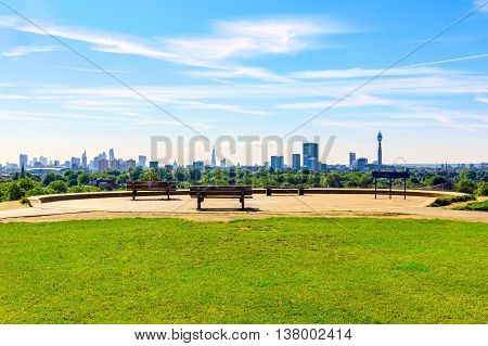 Panoramic view of London cityscape seen from Primrose Hill on a sunny day