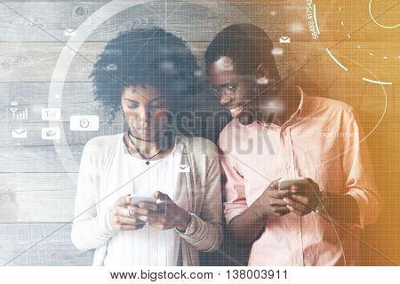 Worldwide Connection Interface. African Couple Using Gadgets: Smiling Man Holding Mobile Phone Looki