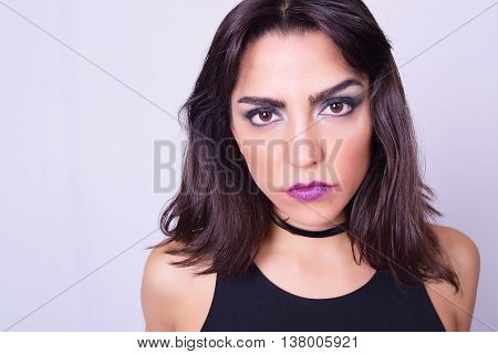 Closeup Of Young Caucasian Woman Isolated Over Grey Background