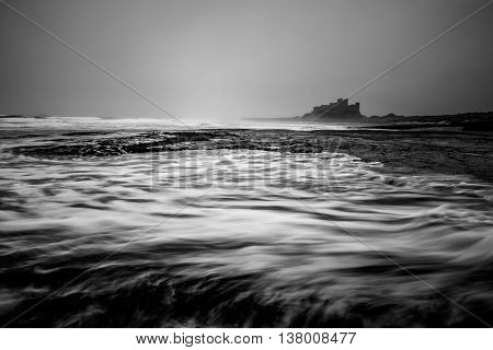 A view of Bamburgh castle in northumbria Long exposure.