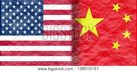 Image relative to politic relationships between United States and China. National flags textured by crumpled paper