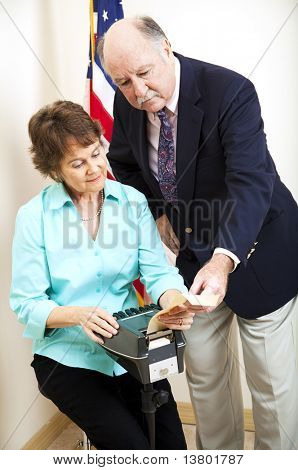 Court stenographer and attorney going over a transcript together.