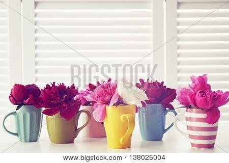 Beautiful peony flowers on white folding screen background