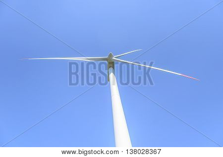 The blades of the wind motor against the sky. Close-up.
