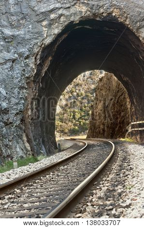 railroad tracks and the tunnel carved in stone entrance in dalmatian hinterland near labin dalmatia croatia