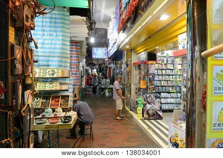 HONG KONG - NOV 9: Hong Kong Temple Street at night on Nov 9, 2015 in Kowloon, Hong Kong. Temple Street is famous for its night market and busiest flea markets at night in Hong Kong.