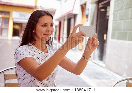 Secretive Smiling Young Girl Taking Pictures