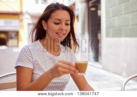 Girl Drinking Coffee In A Street Cafe
