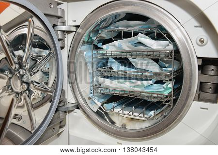 Dental instruments sterilization in autoclave, technolgy uses steam and pressure.