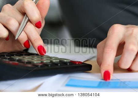 Hand Of Businesswoman Point Finger To Financial Table