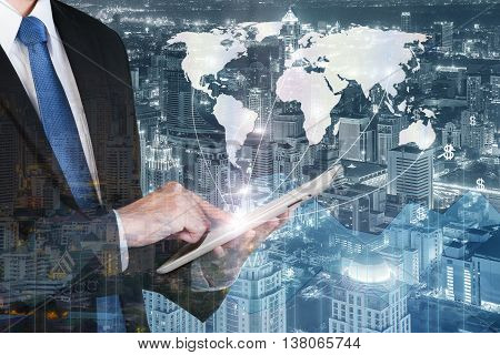 Business technology concept - Business man press digital tablet to show global network business partnership connection with financial business graph. (Elements of this image furnished by NASA)