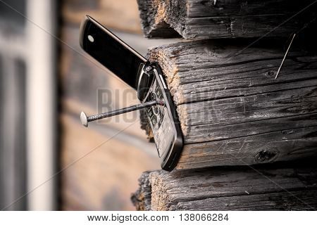 Phone Nailed To The Wood