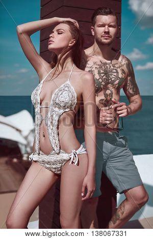 Fashion Beautiful Couple Getting A Suntan
