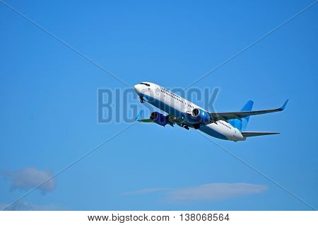 SAINT PETERSBURG RUSSIA - MAY 11 2016. VQ-BTC Pobeda Airlines Boeing 737 Next Gen airplane closeup. Airplane is flying in the sky after departure from Pulkovo International airport