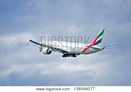 ST PETERSBURG RUSSIA - MAY 11 2016. A6-EBY Emirates Airline Boeing 777 airplane closeup view in flight. Airplane is flying in the sky after departure from Pulkovo airport in St Petersburg