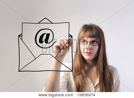 Businesswoman drawing an e-mail envelope
