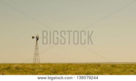 A lonely windmill on the high plains of Eastern New Mexico.