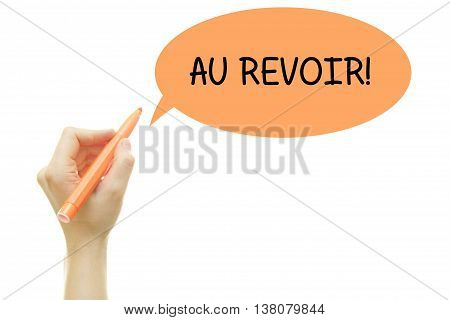 Woman hand writing French word AU REVOIR (goodbye) with a marker isolated on white.