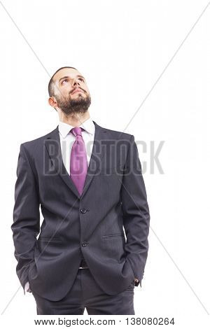 Thoughtful business man looking up, isolated on white background