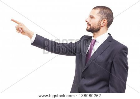 Business man pointing at copyspace, isolated on white background