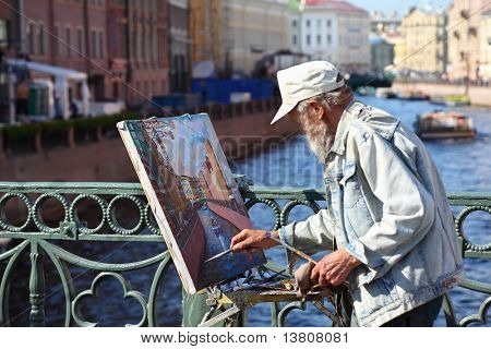 "SAINT-PETERSBURG - MAY 21: Unidentified painter paints on Nevskom prospectus, May 21, 2010 in Saint-Petersburg, Russia. Saint-Petersburg has also been nicknamed "" Venice of the North""."