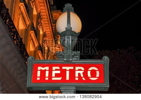 Paris Metro Sign at Night in France.