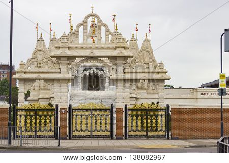 London United Kingdom - June 3 2016: View of the Shri Swaminarayan Hindu Mandir temple or Neasden temple due to its location the first and biggest traditional hindu stone temple of England in London United Kingdom.