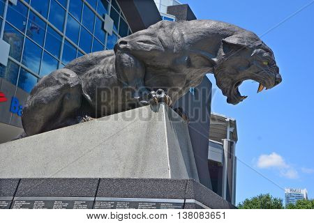 CHARLOTTE NORTH CAROLINA JUNE 21 2016: Bronze statue of the Carolina Panther in front of their home Bank of America Stadium.