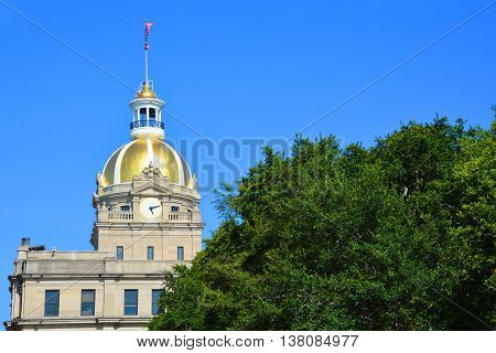 SAVANNAH SOUTH CAROLINA JUNE 29 2016: City Hall with gold dome. Savannah's City Hall was built in 1905 on the site of the 1799 City Exchange.
