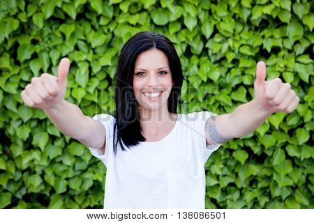 Cool brunette girl saying Ok with thumbs up