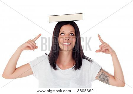 Brunette cool girl balancing a book on the head - isolated on white background