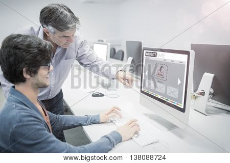 Composite image of website interface against businessman pointing at computer while explaining colleague