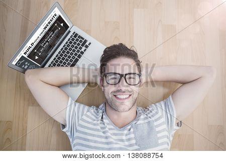 Composite image of build website interface against overhead portrait of a man using laptop