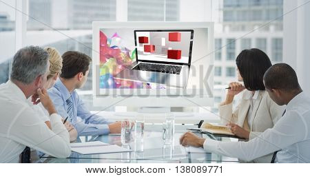 Business people looking at blank whiteboard in conference room against a laptop with graphic background
