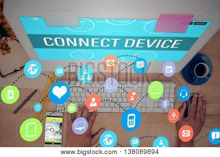 Colourful icons against high angle view of businessman working on computer