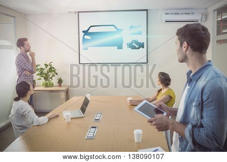 Mechanic graphics against creative business team making presentation