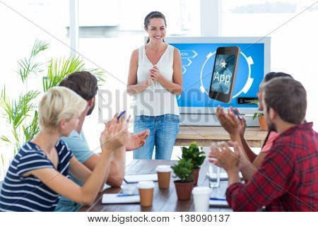 Colleagues clapping hands in a meeting against ad for a new application