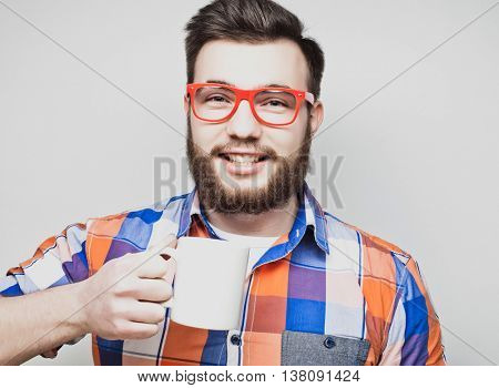 bearded man with a cup of coffee