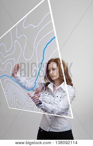 Geographic information systems concept, woman scientist working with futuristic GIS interface on a transparent screen.