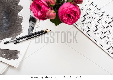 Styled tabletop mockup, computer keyboard and pink flowers on white table, freelancer girl's workspace