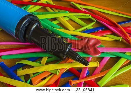 Pump And Color Balloons On A Wooden Background