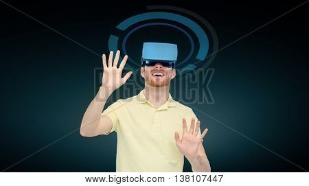 3d technology, virtual reality, cyberspace, entertainment and people concept - happy young man with virtual reality headset or 3d glasses playing game over black background