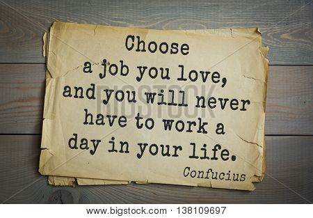 Ancient chinese philosopher Confucius quote on old paper background.  Choose a job you love, and you will never have to work a day in your life.
