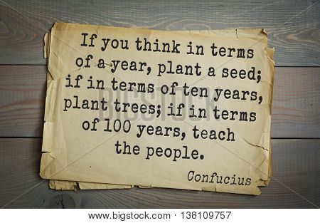 Ancient chinese philosopher Confucius quote on old paper background. If you think in terms of a year, plant a seed; if in terms of ten years, plant trees; if in terms of 100 years, teach the people.