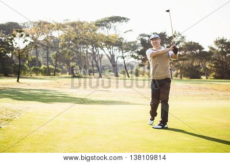 Sportsman playing golf on a field
