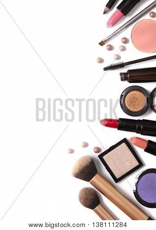 A selection of make up beauty products isolated on a white background forming a page border