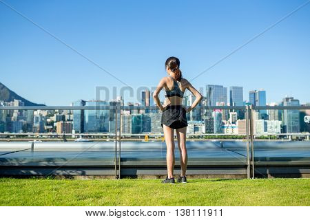Sporty woman standing in the city